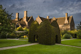 Yew topiary house on the large lawn, or pleasaunce, at the fifteenth-century Great Chalfield Manor, Wiltshire