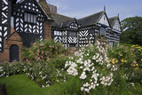 The South Front with black & white timberwork at Speke Hall, Merseyside