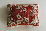 Red and white embroidered pin cushion in the South Bedroom at Hughenden Manor, Buckinghamshire, home of prime minister Benjamin Disraeli between 1848 and 1881