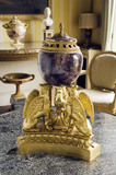 A perfume burner with a vase of blue john and ormolu supports in the form of three griffins by Matthew Boulton (1728-1802), in the Drawing Room at Hinton Ampner, Hampshire