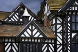 Windows, gables and black & white timberwork on the north front at Speke Hall, Merseyside