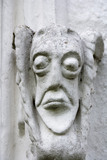 Grotesque face on the east front of Bradley Manor, a medieval manor house at Newton Abbot, Devon
