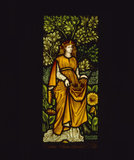 Autumn, one of four panels of stained glass in the inglenook fireplace in the Dining Room, designed by William Morris, dated 1873