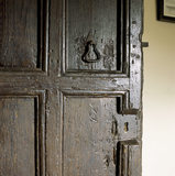 Detail of a seventeenth century panelled door on the Landing at Woolsthorpe Manor
