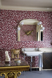The Bathroom at Hinton Ampner, Hampshire, showing the wash basin and wallpaper
