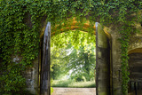 Four pointed arched gateway in the ancient curtain wall at the fifteenth-century Great Chalfield Manor, Wiltshire