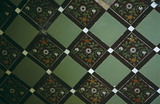 Close up of Victorian tiles in the gazebo in the Old Rose Garden at Tyntesfield, North Somerset