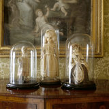 Close view of three eighteenth/nineteenth century dolls in glass display cases on the State Bedroom Landing at Clevedon Court