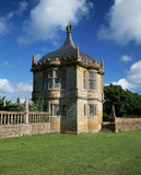 An ornate garden pavilion in the corner of the garden at Montacute