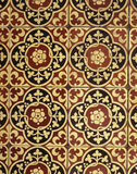 A detail of the Minton tiles on the hearth floor in the fireplace of the Billiard Room at Dunster Castle