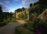 The Orangery at Powis Castle with a path and bushes in the foreground