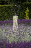 A glimpse of the Lavender Garden at Polesden Lacy, in July, at the centre is an armillary sphere on a plinth