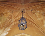 Detail of the ribbed stone carving of the ceiling in the East Front Entrance at Tyntesfield, with a decorative lantern