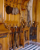 A corner of a Plucknett and Collier cupboard in the Entrance Hall, & hats on pegs with walking sticks, canes and shepherds crooks in stands at Tyntesfield