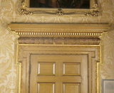 Detail of oak gilded door pediment in the Speakers Parlour at Clandon Park, incorporating the 1st Earl's coronet