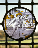 Detail of stained glass roundel representing September [a man sowing] in Queen Mary's Room at Packwood House