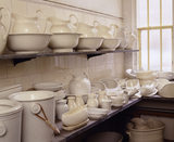 View of the servants' sanitary ware, showing a range of plain white ceramic washing jugs, bowls & chamber pots at Tyntesfield