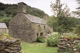 End on view of Ty Mawr in Wales, and outbuilding, restored to its probable 16th/17th century appearance