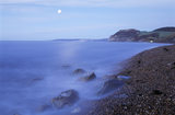 Moonlight along the coast at East Ebb looking towards Golden Cap