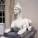 Close up of one of the lead female sphinx by the west door at Saltram