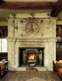 A view looking towards the carved stone chimneypiece with shields commemorating Ferrer family marriages
