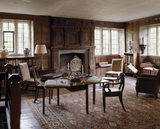 The Library showing the fireplace, overmantel which bears the date 1634, oak table and chairs