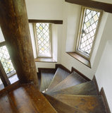 Looking down spiral staircase with windows in part of Stoneacre that was possibly built in the 1920's