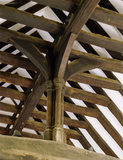 Detail of cross-beam and queen post in the roof of the Great Hall at Stoneacre, a fifteenth-century Wealden house in Kent