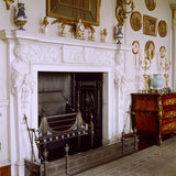 The carved Carrara marble fireplace in the Drawing Room