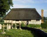 The west-facing front of the C14th timber framed house