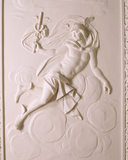 Detail of the plasterwork on the Entrance Hall ceiling at Saltram, showing the life-size figure of Mercury, god of good fortune, wealth and roads