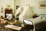 The late C19th. Night Nursery, with a bed and canopied cots