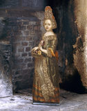 An early eighteenth century dummy board from the Great Chamber at Trerice, depicting a girl holding a basket of flowers