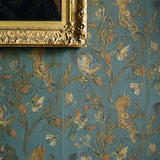 Detail of the 19th century wallpaper in the Library at Dunster Castle with stimulated blue embossed leather known as Cordelova
