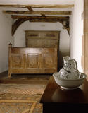 The West Bedroom, showing a Flemish C17th, carved and panelled oak bed, with a cupboard with sliding doors surmounting its head