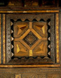 Detail of the inlay on the Blue Bedroom bed, which is said to have been made from wood from a Spanish Armada galleon wrecked on the Kent coast in 1588
