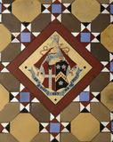 Detail of the Legh family coat of arms on the Minton floor tiles in the Orangery