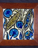 A colourful tile at Standen designed by William de Morgan in the Billiard Room