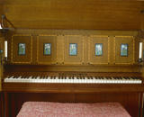 "The keyboard of the ""Manxman"" piano in the Hall at Standen, West Sussex"