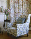 Armchair in the North Bedroom at Standen, West Sussex with the embroidered hangings behind by Margaret Beale and her three eldest daughters in about 1896