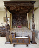 The Kitchen Chamber, with mid-seventeenth century Cornish oak bed and cradle, at East Riddlesden Hall, West Yorkshire