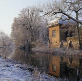 View upstream with frosty trees and ground looking towards Walsham with a brick building on river edge