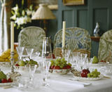 Close view of the table in the Dining Room set for dessert at Standen, West Sussex