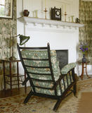 Back of armchair facing the fireplace in the Morning Room at Standen, West Sussex