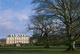 Exterior view of Antony House across lawn and mature trees