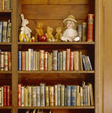 The Night Nursery at Lanhydrock, showing a range of small toys and books on shelves
