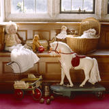 A view of the Night Nursery including a rocking horse and dolls at Lanhydrock