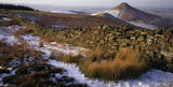 A panoramic winter scene of Roseberry Common, with the Topping prominent