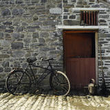 A bicycle from many left on the estate outside a stable in the Farm Yard on the Llanerchaeron Estate