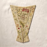 View of a stomacher dating from the first half of the c18th made of ivory silk embroidered with silver thread and coloured silks